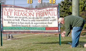 SIGN DESIGNED BY ATHEIST HATE GROUP TO PROVOKE AND OFFEND CHIRSTIANS.