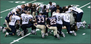 MARK OPPENHEIMER SUGGESTS NFL PRAYER CIRCLES ARE LITTLE MORE THAN 'CAREFULLY CALIBRATED ROUTINE.' CHRISTIAN FACADE.