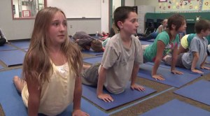 TENDER-AGED STUDENTS IN ENCINITAS, CALIFORNIA INDICTRINATED IN ASHTANGA YOGA.